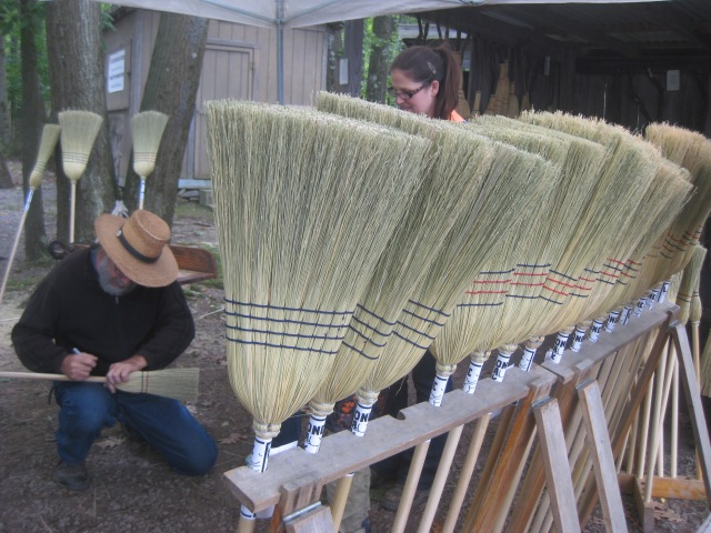 Some little kids asked this broom maker to sign their brooms.
